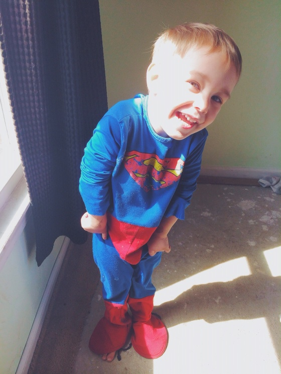 This goofball...he asked me to take a picture of him in his Superman suit making a face :) haha